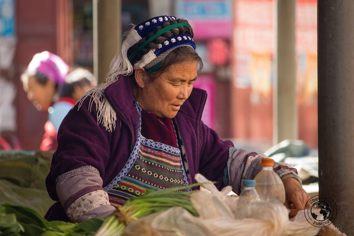 Woman in traditional clothing in Xizhou - Yunnan Travel - A two-week Itinerary for Yunnan