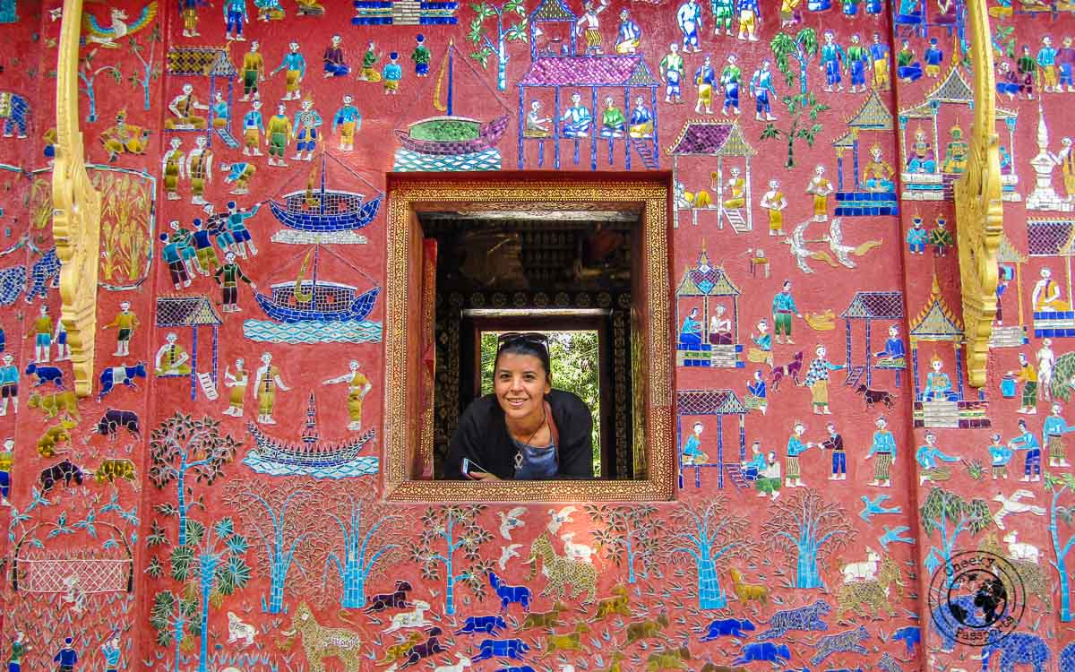 Michelle peeping from one of windows of the temples in Luang Prabang