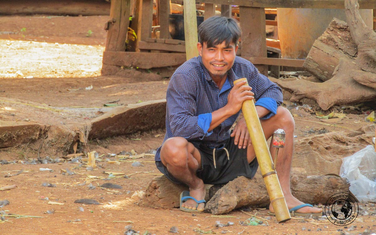 Southern Laos - Local man smoking bamboo bong in Captain Hook's village