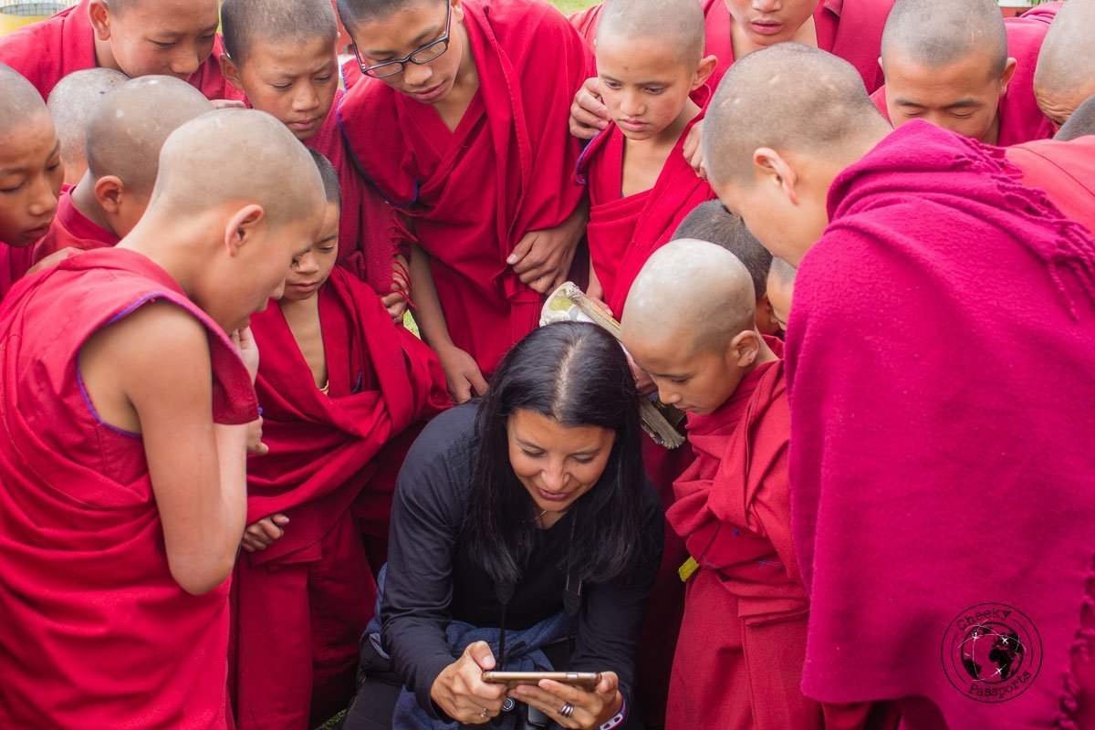 Curious monks checking michelle's pictures at the Bomdila Monastery - Explore Dirang and Bomdila in Arunachal Pradesh - Northeast India Travel