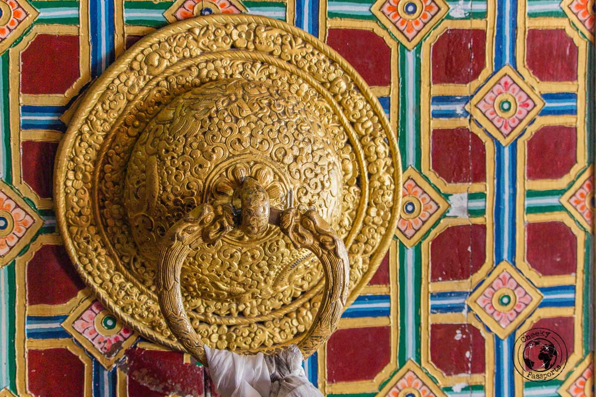 Decorated golden door knob at the tawang monastery - Guide to Sela Pass, Tawang Monastery and other Places to Visit in Tawang