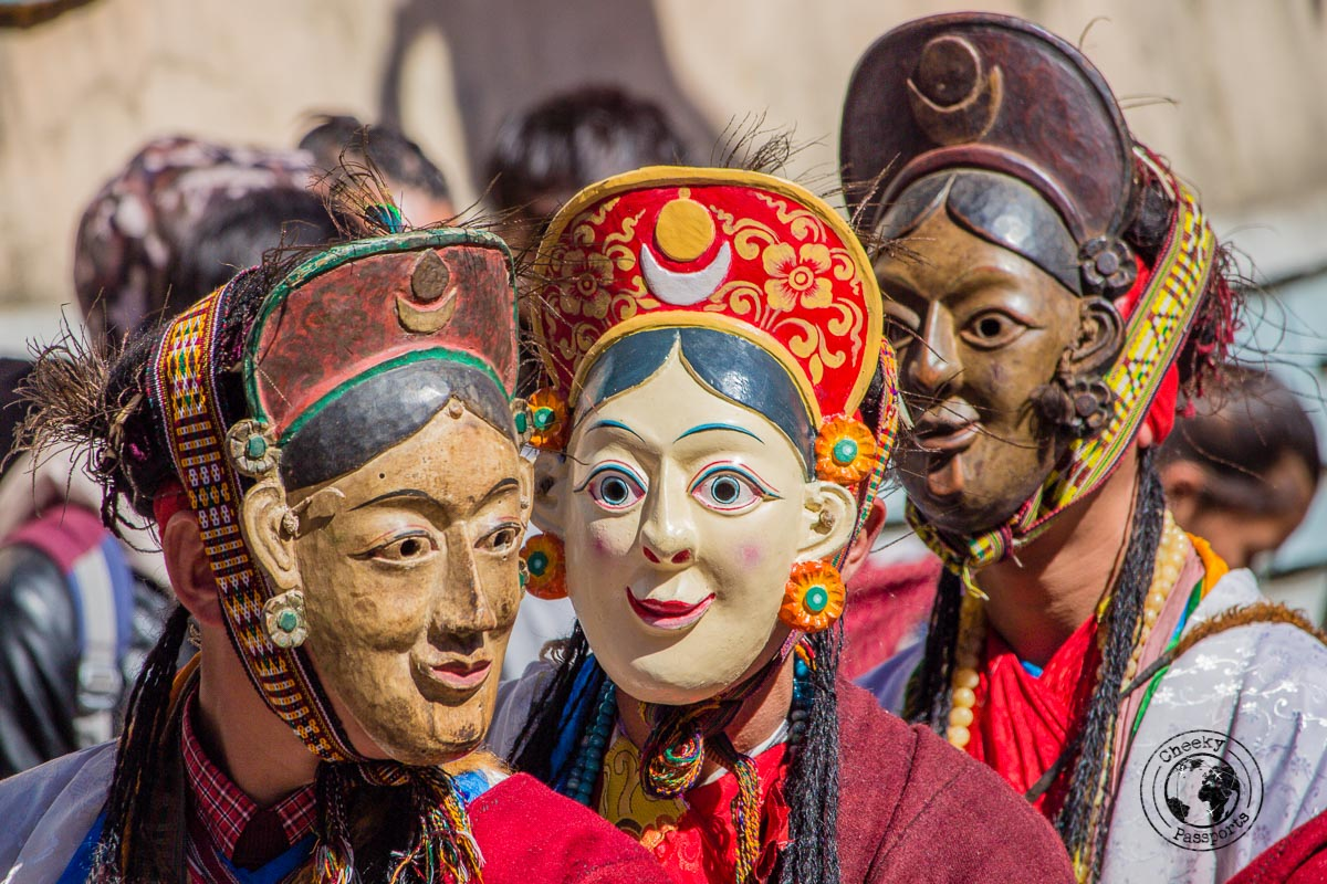 Masked participants at the Tawang festival parade - North East India Travel Guide