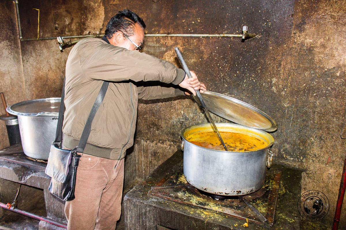 Preparing lunch for the monastery students is a tough job and requires a huge pan - Guide to Sela Pass, Tawang Monastery and other Places to Visit in Tawang