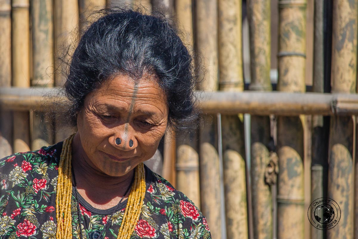 Apatani woman showing us her face decorations - North East India Travel Guide