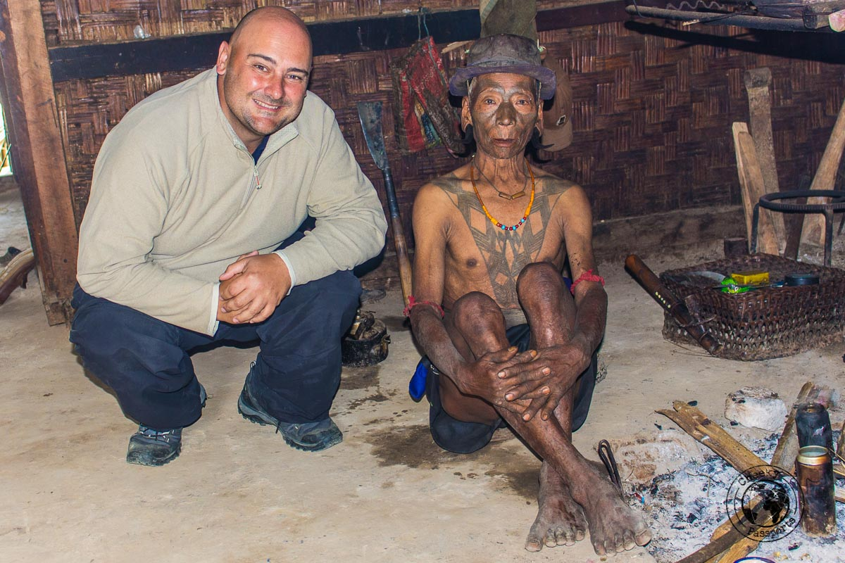 Nikki making friends with the local former headhunters of Longwa, Nagaland