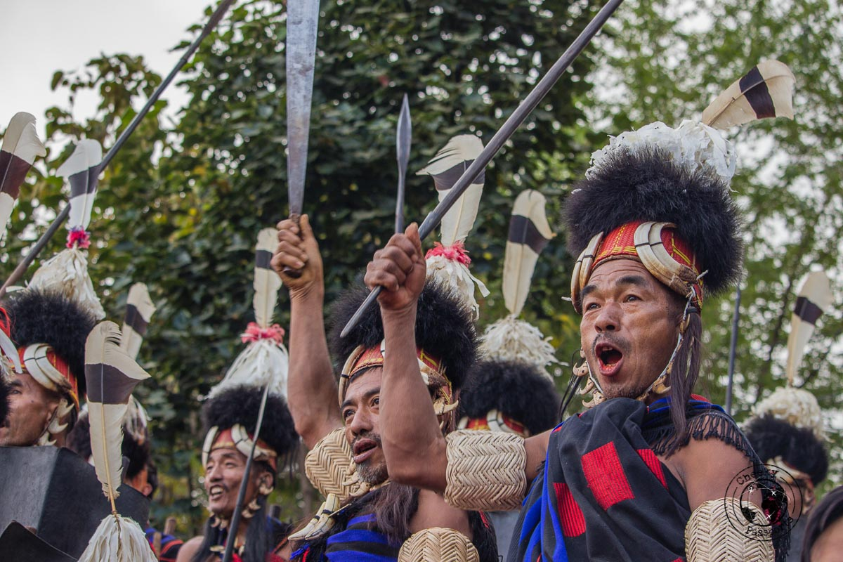 Tribes cheering to their fellow men at the Nagaland hornbill festival