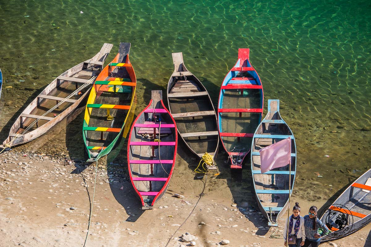 Colourful boats waiting for tourists at the dawki river in meghalaya