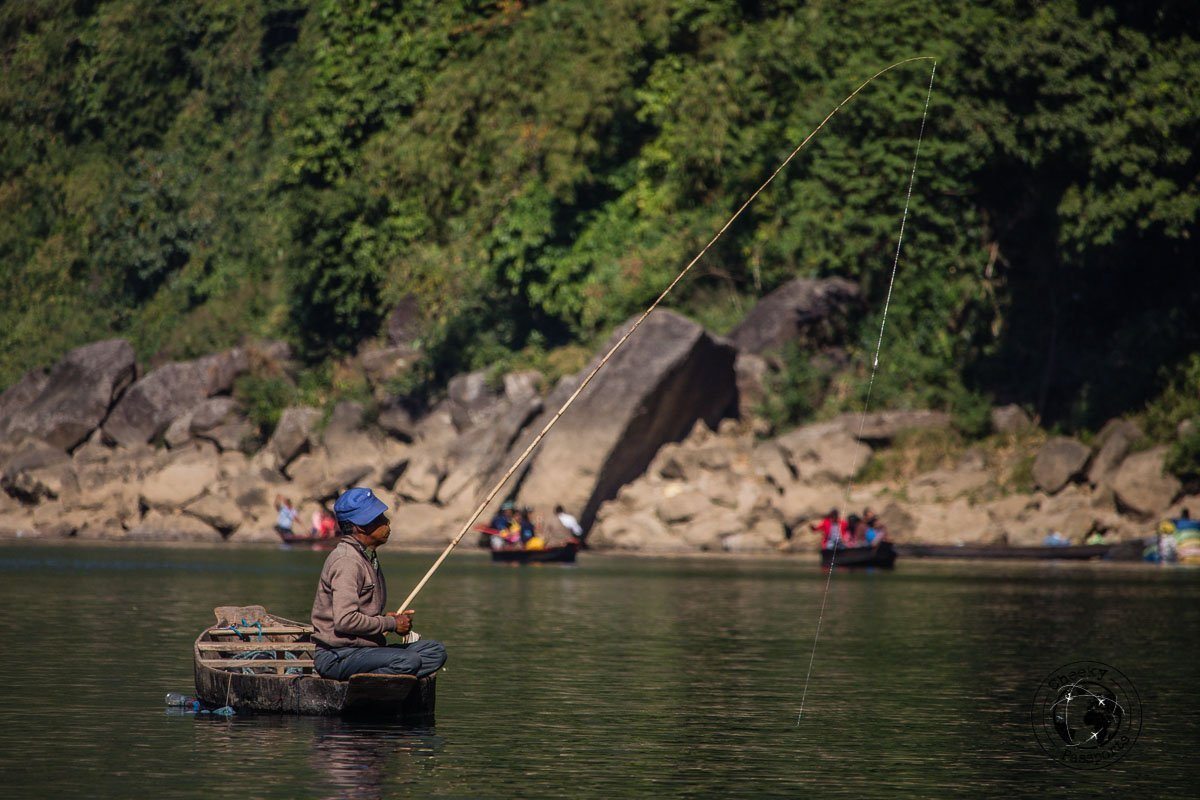 Fishing in bliss at the dawki river, one of the top places to visit in meghalaya