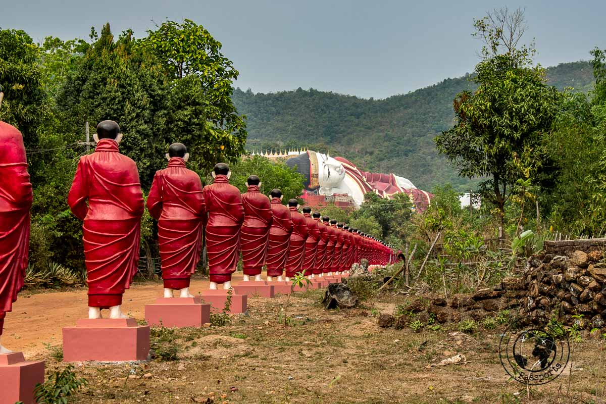 monk statues leading to the reclining buddha - things to do in Mawlamyine