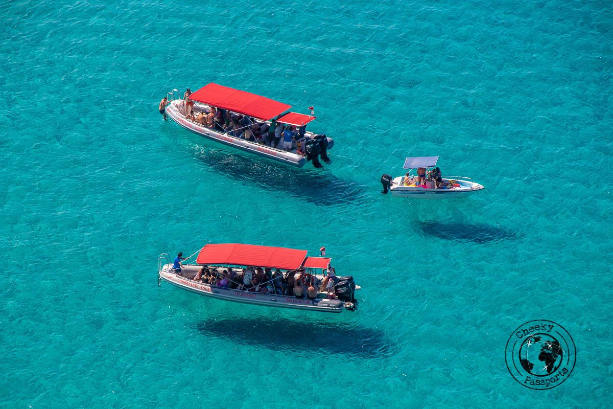 Tourist boats taking tourists around the lovely seas around the best tropea beaches