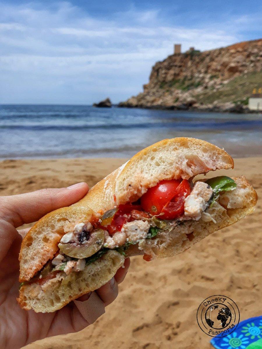 Enjoying the Maltese Ftira at the beach