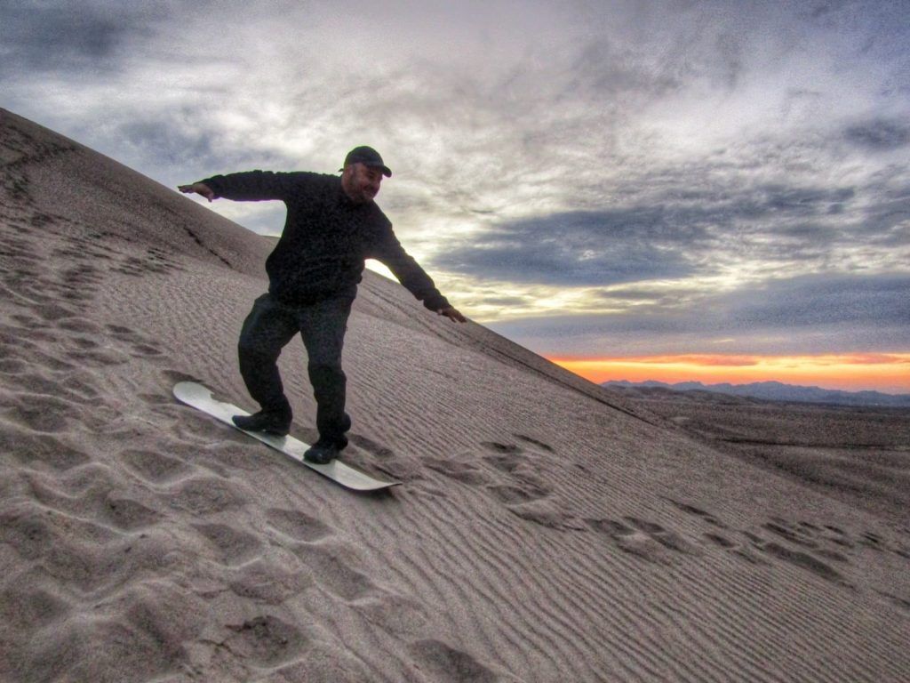 Faking his way with some sand boarding