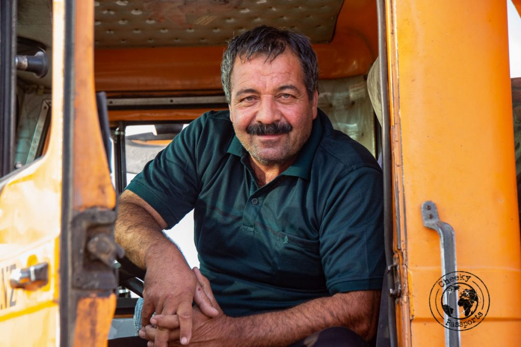 Friendly Iranian truck driver working the salt flats